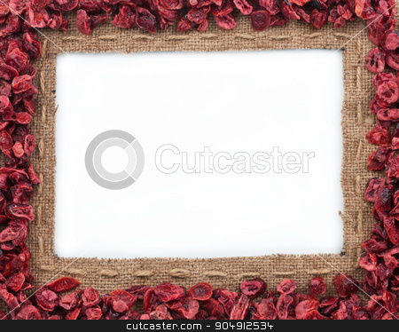 Frame made of burlap with dried cranberries stock photo, Frame made of burlap with dried cranberries, on a white background by alekleks