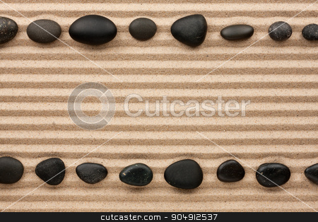 Two rows of black stones  on the sand stock photo, Two rows of black stones  on the sand, with space for text by alekleks