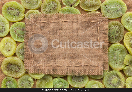 Frame made of burlap on dried kiwi stock photo, Frame made of burlap on dried kiwi, with space for your text by alekleks