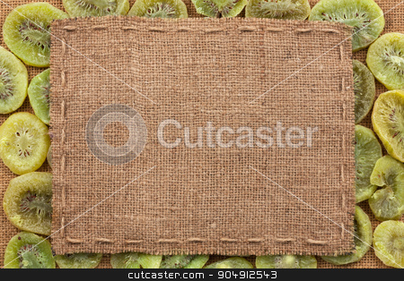 Frame made of burlap with the line lies on kiwi stock photo, Frame made of burlap with the line lies on kiwi, with place for your creativity by alekleks
