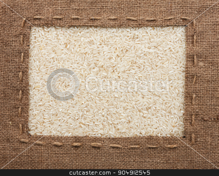 Frame made of burlap with the line lies on  rice  grains stock photo, Frame made of burlap with the line lies on  rice  grains, can be used as background by alekleks
