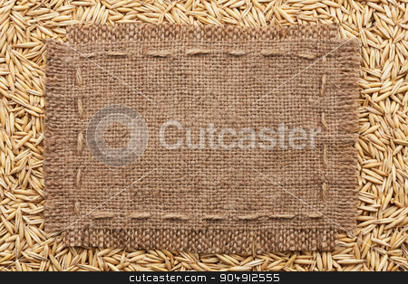 Frame of burlap  lying on a oats  background stock photo, Frame of burlap  lying on a oats  background, with place for your text by alekleks