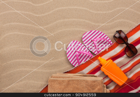 Women's accessories for the beach lying on the sand stock photo, Women's accessories for the beach lying on the sand, with place for your text by alekleks