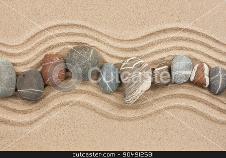 Striped stones on the sand stock photo, Striped stones on the sand,can be used as background by alekleks