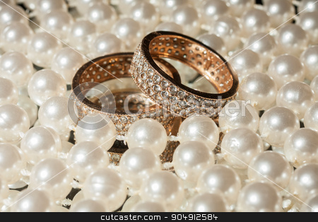Wedding rings and necklaces stock photo, Wedding rings and necklaces, wedding concept by alekleks