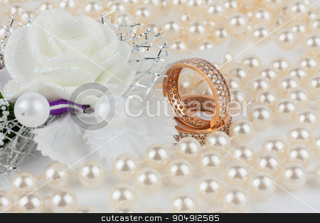 Wedding rings among the pearls with flower stock photo, Wedding rings among the pearls with flower, as background by alekleks