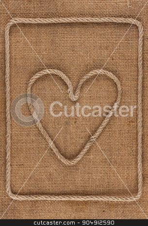 Heart made of rope on burlap stock photo, Heart made of rope on burlap, conceptual image by alekleks