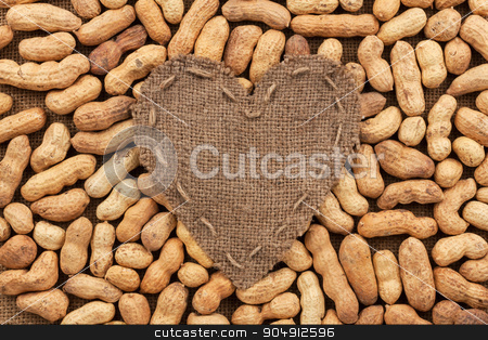 Heart of  burlap, lies on a background of peanut stock photo, Heart of  burlap, lies on a background of peanut, with place for your text  by alekleks
