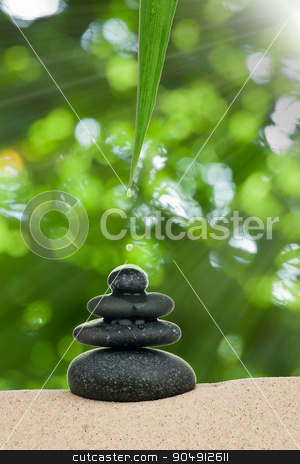 A drop of water drips on the pyramid stone stock photo, A drop of water drips on the pyramid stone, as background by alekleks