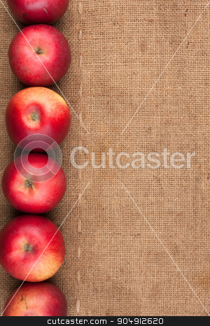 Red apples lie on sackcloth stock photo, Red apples lie on sackcloth, to the menu by alekleks