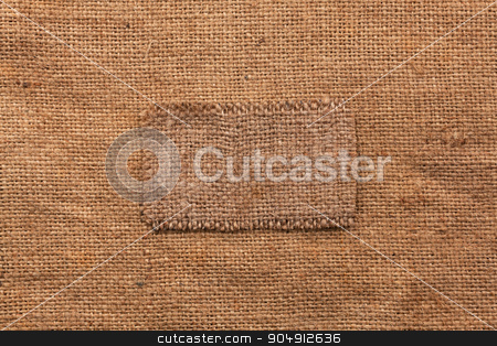 Frame made of burlap  lies on a sacking  background stock photo, Frame made of burlap  lies on a sacking  background,can be used as texture by alekleks
