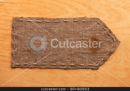 Pointer of burlap, lies on a background of wood stock photo, Pointer of burlap, lies on a background of wood, with place for your text by alekleks