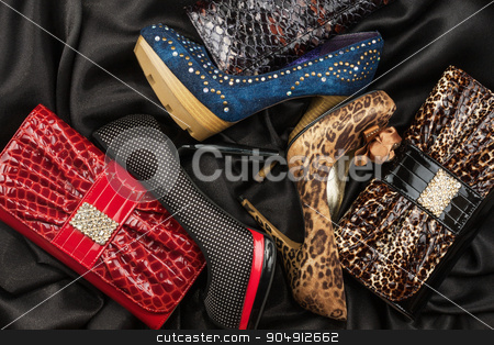 Three shoes and purses are on the black silk stock photo, Three shoes and purses are on the black silk, as background by alekleks