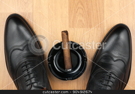 Classic men's shoes, ashtray and  fuming cigar on the wooden flo stock photo, Classic men's shoes, ashtray and  fuming cigar on the wooden floor, can be used as background by alekleks