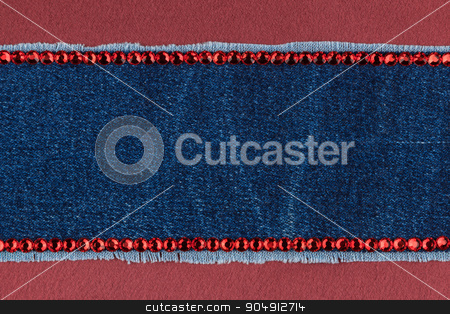 Fashionable  texture,  jeans and red  rhinestones on a red silk stock photo, Fashionable  texture,  jeans and red  rhinestones on a red silk, with space for your text by alekleks