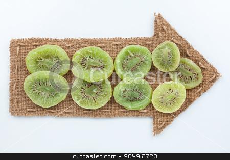Pointer of  burlap with dried kiwi stock photo, Pointer of  burlap with dried kiwi, on a white background by alekleks