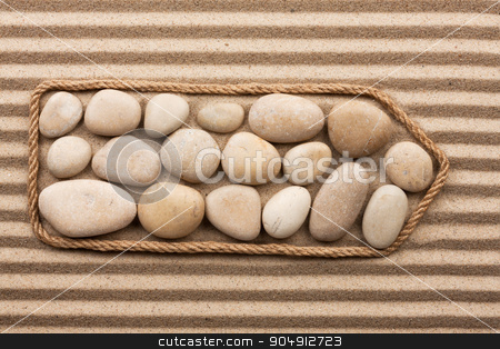 Pointer made of rope with white stones stock photo, Pointer made of rope with white stones, lying on the striped sand by alekleks