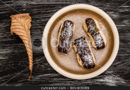 Ekler, Delicious German Dessert, Famous in Turkey  stock photo, Ekler, Delicious German Dessert, famous in Turkey in brown plate by OZMedia
