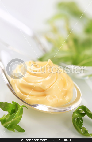 Salad dressing  stock photo, Swirl of salad dressing on a spoon by Digifoodstock