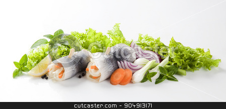 Herring rollmops stock photo, Pickled herring fillets rolled and  filled with onion and carrot by Digifoodstock
