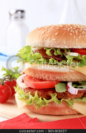Double burger  stock photo, Sesame seed bun sandwich with beef patty, parma ham and cheese by Digifoodstock