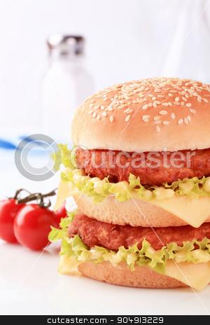 Double cheeseburger stock photo, Closeup of a double cheeseburger by Digifoodstock