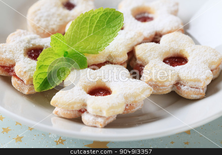 Jam cookies stock photo, Jam filled cookies sprinkled with icing sugar by Digifoodstock