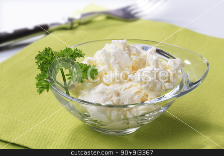Bowl of curd cheese stock photo, Bowl of curd cheese garnished with parsley by Digifoodstock