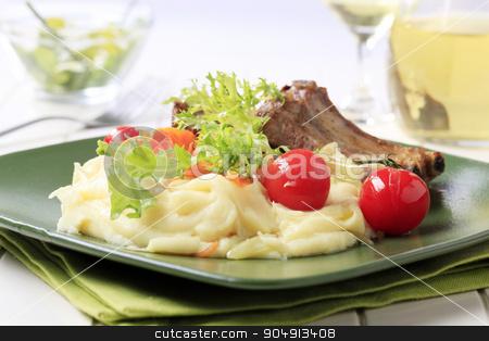 Roasted pork ribs and mashed potato stock photo, Roasted pork ribs and mashed potato - closeup by Digifoodstock