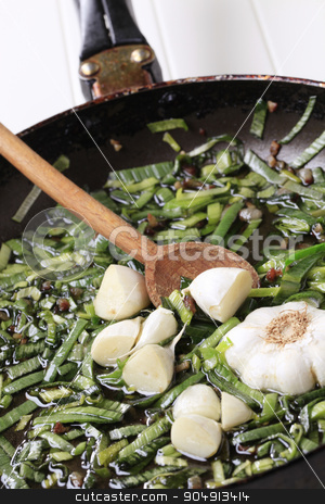 Stir frying spring onion and garlic stock photo, Chopped spring onion and garlic on a frying pan by Digifoodstock