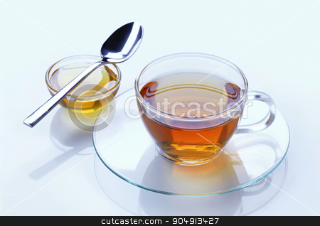 Cup of tea and honey stock photo, Cup of tea and honey - studio shot by Digifoodstock