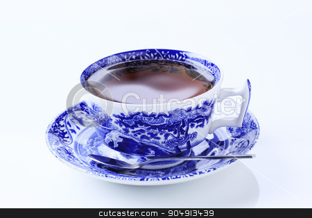 Cup of tea stock photo, Hot tea in an ornate teacup by Digifoodstock