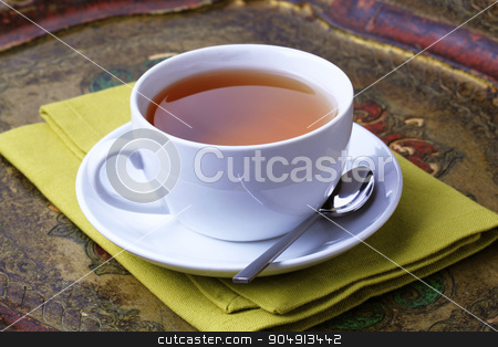 Cup of tea stock photo, Cup of black tea on an antique tray by Digifoodstock
