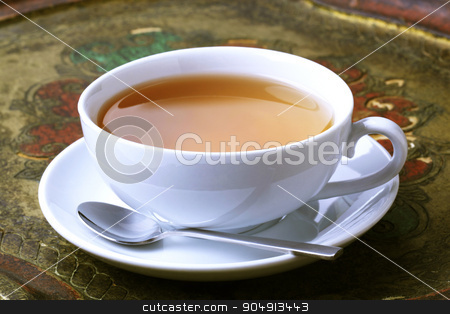 Cup of tea stock photo, Cup of tea on an antique tray by Digifoodstock