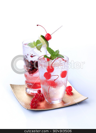 Iced drinks stock photo, Glasses of iced drinks garnished with fruit by Digifoodstock