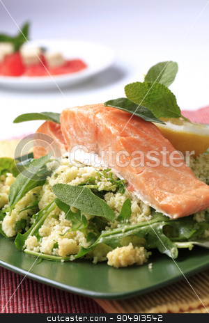 Salmon fillet with couscous stock photo, Salmon fillet with couscous and rocket salad garnished with fresh sage leaves by Digifoodstock