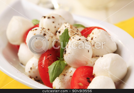 Caprese salad stock photo, Bowl of mozzarella cheese, tomato and basil by Digifoodstock
