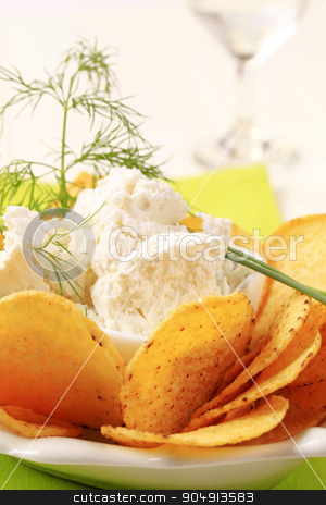 Corn chips with fresh cheese stock photo, Bowl of tortilla chips and curd cheese by Digifoodstock