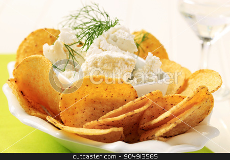 Corn chips with cheese stock photo, Bowl of tortilla chips and curd cheese by Digifoodstock
