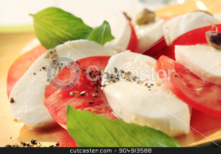 Caprese salad stock photo, Slices of fresh mozzarella cheese and tomato by Digifoodstock