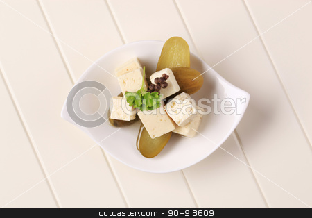 Feta cheese and pickles stock photo, Cubes of marinated feta cheese and pickles by Digifoodstock