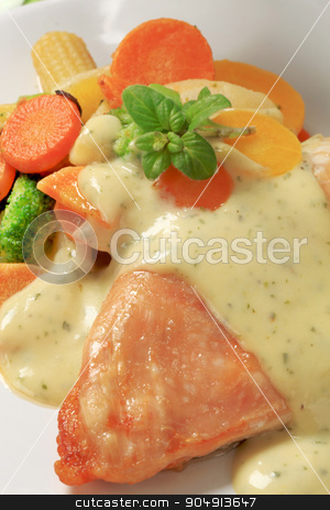 Chicken breast and mixed vegetables poured with sauce stock photo, Chicken breast and mixed vegetables poured with cream sauce by Digifoodstock