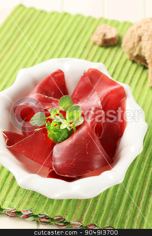 Dried meat stock photo, Thin slices of dried meat in a bowl by Digifoodstock
