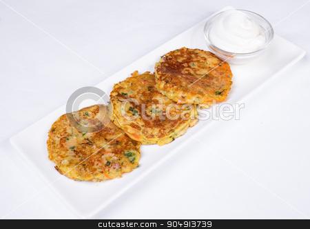 Potato Pancake with Sour Cream stock photo, Potato Pancake with Sour Cream on a white background by ALEKSANDR