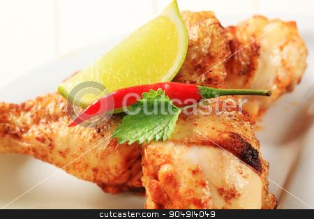 Spicy chicken drumsticks  stock photo, Spicy chicken drumsticks with crispy skin - detail by Digifoodstock