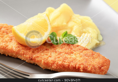 Fried fish with mashed potato stock photo, Fried battered fish fillet with potato puree and lemon by Digifoodstock