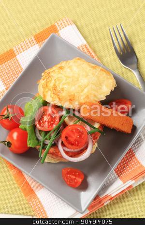 Salmon burger and fish stick stock photo, Salmon burger and fish stick with vegetable garnish by Digifoodstock