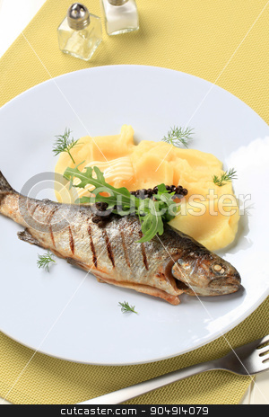 Grilled trout with mashed potato stock photo, Dish of grilled whole trout and mashed potato by Digifoodstock