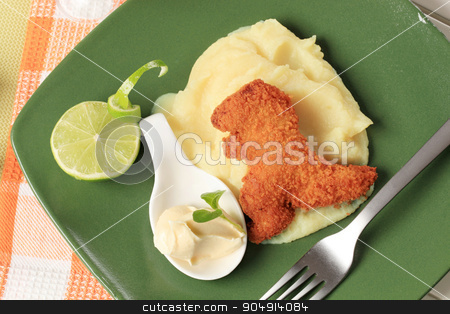 Fried dinosaur-shaped nugget with mashed potato stock photo, Fried breaded dinosaur-shaped nugget with potato puree by Digifoodstock