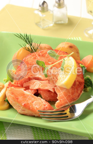 Salmon patty with mixed vegetables stock photo, Salmon burger patty with mixed vegetables and potatoes by Digifoodstock